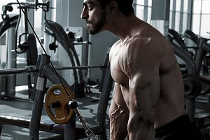 Young Bodybuilder Doing Exercise For Triceps
