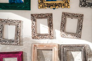 Vintage picture frames on a white wall