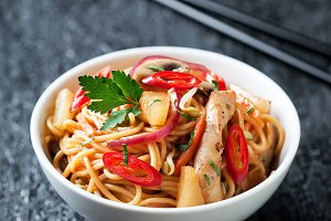 Noodles with vegetables, chicken and pineapple in sweet and sour sauce