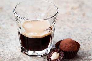 Chocolate nut truffles and glass of espresso