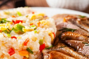 Fried duck breast and rice