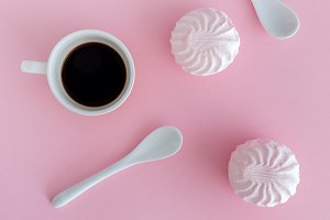 Cakes and frash coffee on a pink