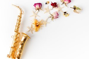 Jazz Day. Saxophone with flowers. Flat lay, top view