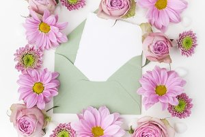 Envelop with pink flowers frame. Flat lay. Top view