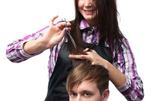 hairdresser cutting hair of man