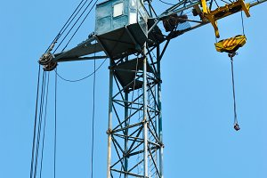 tall tower crane with a cabin