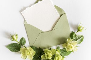 Empty cardboard card with flowers and an envelope
