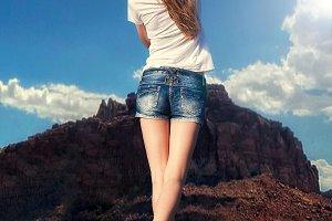 girl walking along desert road