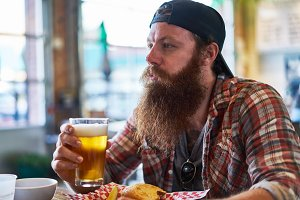 bearded guy drinking beer