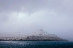 Dark Ocean and Foggy Mountains