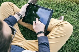Hipster using digital tablet