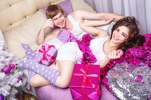 Couple hugging. Christmas in bed.