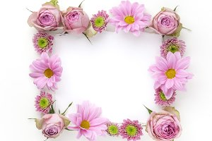 Pink flowers frame with space for text. Flat lay. Top view