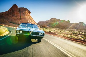 driving vintage hot rod in desert