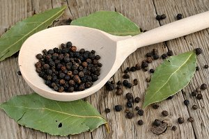 Black pepper in spoon