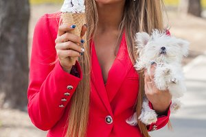 woman with icecream and little puppy