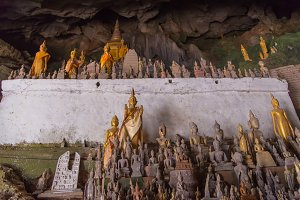 Buddha statue in cave at Laos.