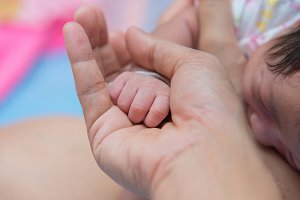 baby hand in mom's palm.