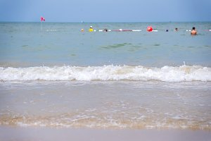 wave of sea on the sandy beach.