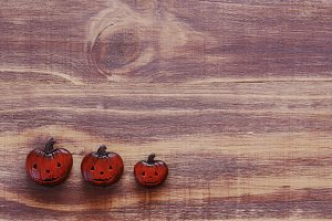 Decorative pumpkins for Halloween on a wooden background