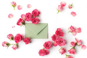 Envelop with white card and rose