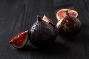 Juicy ripe fruit figs dark wooden background
