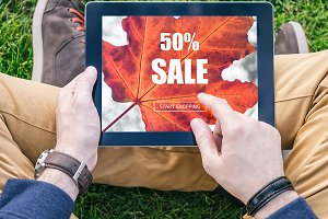 Man using tablet for sale shopping