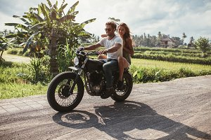 Young couple riding motorbike