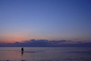 Couple at sunset at sea