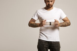 Hipster in white t-shirt holding aeropress