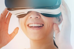 Smiling woman using the virtual