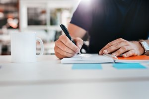 Businessman hands writing notes