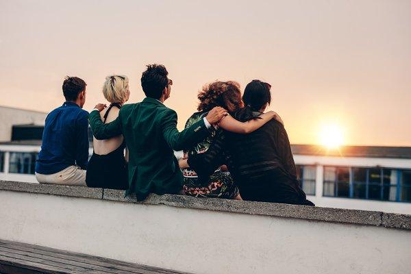 Friends relaxing on terrace