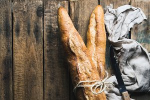 French baguettes on rustic texture