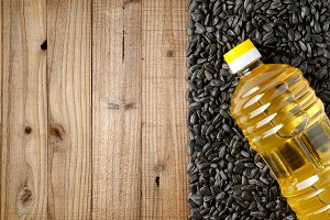 Sunflower seeds and bottle of oil