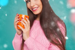 model holding a cup of hot drink