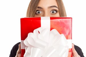 Model holding red present box