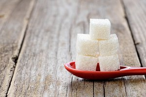 White sugar cubes in spoon
