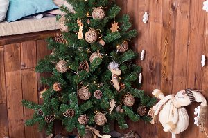 Decorated Christmas tree on wooden background