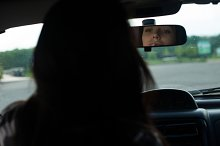 rearview mirror in a black car.