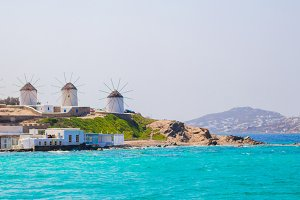 Panorama of famous view of traditional greek windmills on Mykonos island at sunrise, Cyclades, Greece