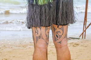 Maori with tattoos on both legs