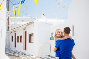 Family in Europe. Happy father and little adorable girl in Mykonos during summer greek vacation