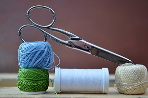spool of sewing thread,scissors