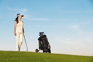 Young woman playing golf.