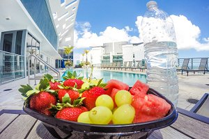 Fresh snack of fruits with bottle