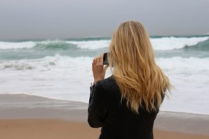 Girl with camera at the beach