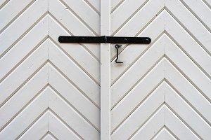 White wooden door with lock and hook