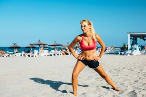 fitness woman does exercise on beach