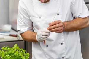 Chef preparing ornamental elements